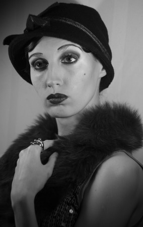 twentieth: Model in luxury clothes in the likeness of famous Hollywood actress of the twentieth century fashion style makeup