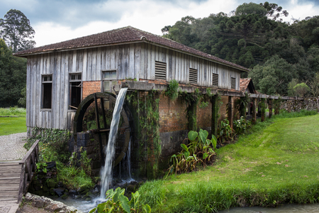 waterwheel: An old wooden house with waterwheel at Rio Grande do Sul - Brazil Stock Photo