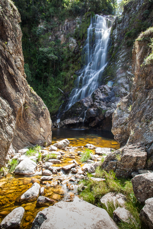 capon: Capon lining waterfalls in Serra da Canastra National Park - Mines Stock Photo