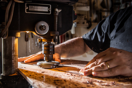 Luthier making an acoustic guitar Stock fotó
