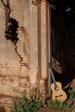 nylon string: Classical acoustic guitar in ruins of abandoned church at Palmital SP - Brazil