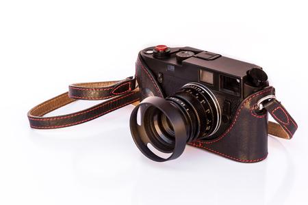 snoot: Black Vintage Film Camera on white background Stock Photo