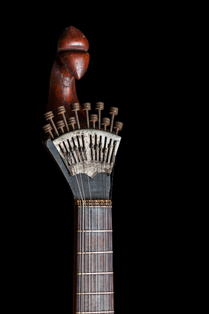 Portuguese guitar,  with tradicional fan (or peachow, watchkey) tuners - black background