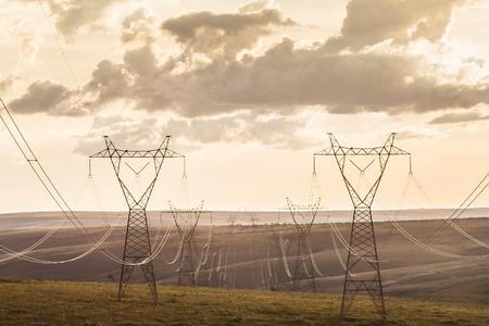 volt: High voltage post. High-voltage transmission lines at sunset Stock Photo