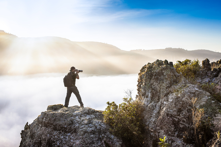 Man with backpack shooting above the clouds - Guartela Canyon - Tibagi/ PR - Brazil