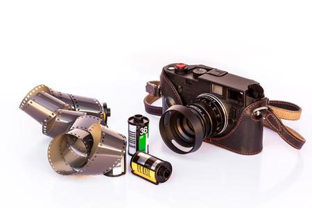 Black Vintage Film Camera and Film Cartridges on white background Stock Photo
