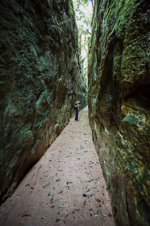 cleft: A cleft in a huge block of rock, made a path with 1km (0.6mi) long, between two stone walls with about 50 to 100ft high, separated by only 16ft - Guartela - Tibagi - Brazil