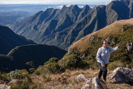 sc: Woman taking a selfie of the cliffs of Ronda Canyon - Bom Jardim da Serra - SC - Brazil
