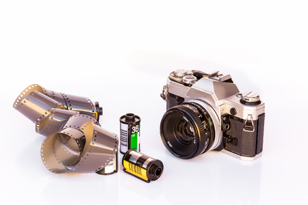 snoot: Vintage Film Camera and Film Cartridges on white background