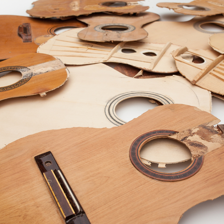 hunker: Old parts of broken guitars Stock Photo