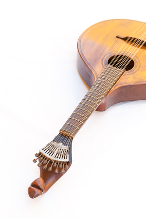 Portuguese guitar,  with tradicional fan (or peachow, watchkey) tuners - white background