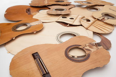 hunker: Old parts of broken guitars Stock Photo