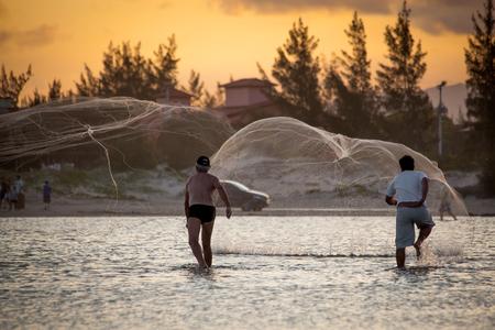 Fishermen at Luz' Beach in Imbituba - Santa Catarina - Brazil Stockfoto