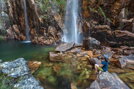Woman looking to Parida Waterfall (Cachoeira da Parida) - Serra da Canastra National Park - Brazil
