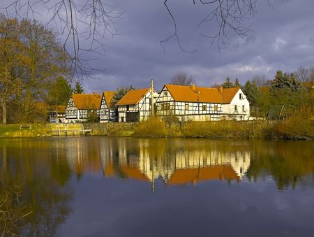 house and pond in Germany Stock Photo