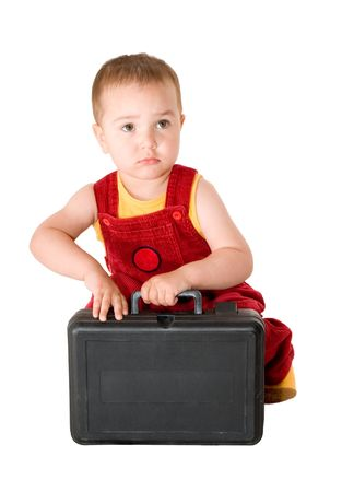 The child in an red helmet with tools on a white background photo