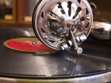 Ancient phonograph with a vinylic plate photo