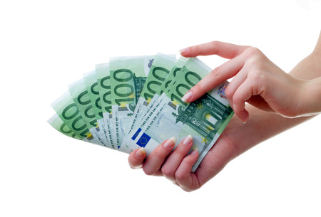 Hand with a pack of paper money photo