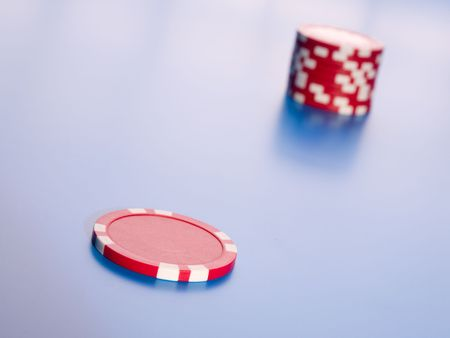 Casino chips in blue background