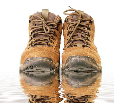 dampness: Pair of tan work boots Stock Photo