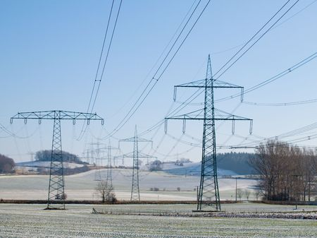 poling: Electric main on a spring field with the pure dark blue sky