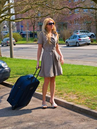 womens clothing: Girl with suitcase Stock Photo