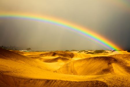 canaria: landscape, rainbow and dunes on gran canaria desert