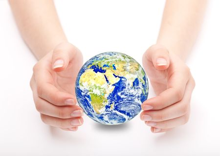 Globe on human hand photo