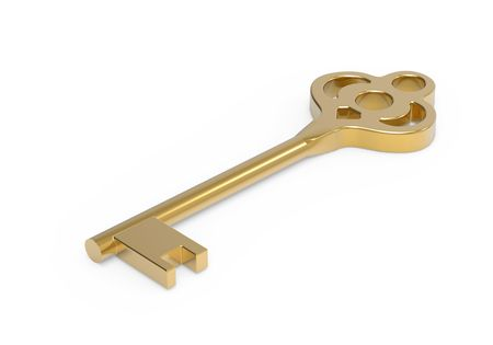 Gold key from house isoladed on white photo