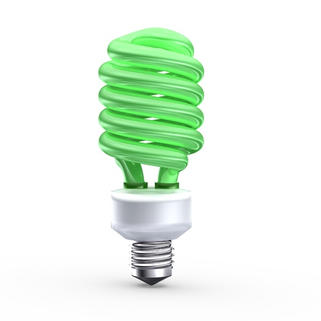 Fluorescent saving light bulb on green background photo