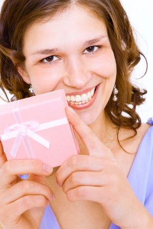 The girl  with a gift in a pink box photo