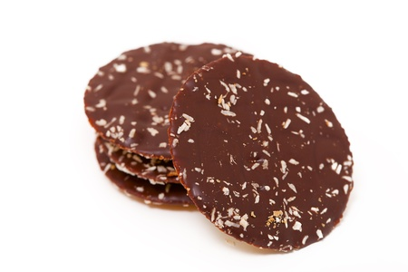 Chocolate cookies with a coconut shaving on a white background photo