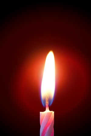 Fire of a red candle on the black Stock Photo - 8591878
