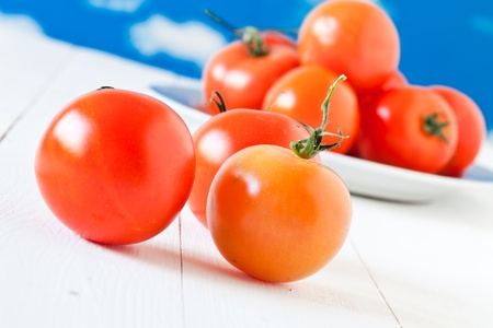 red fresh tomatoes on  wooden table Stock Photo - 8784709