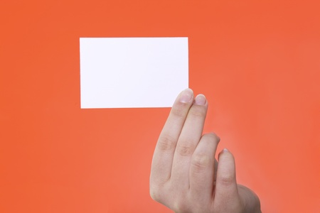 businesscard: Businesscard in hand on red