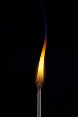 matchstick flame and smoke on black photo