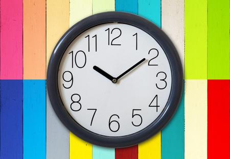 Clock on color wooden plank wall Stock Photo - 9295173