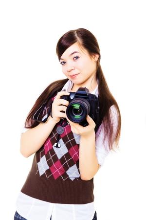 aficionado: joven fot�grafo femenina con c�mara de fotos digital slr