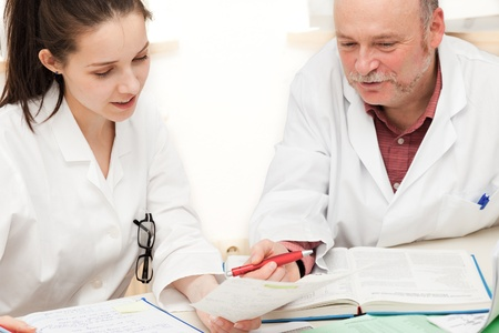 medical scientist: The girl  student  examination to the teacher  professor