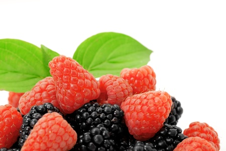 flavours: Ripe  blackberry and raspberry with leaves on white background Stock Photo