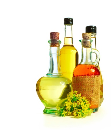 Rapeseed flower and oil in bottle