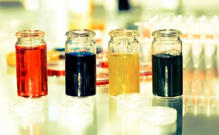 cmyk  ink in glass bottle photo