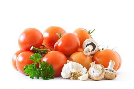 Tomatoes Parsley garlic and  mushrooms isolated on white background Stock Photo - 10536215