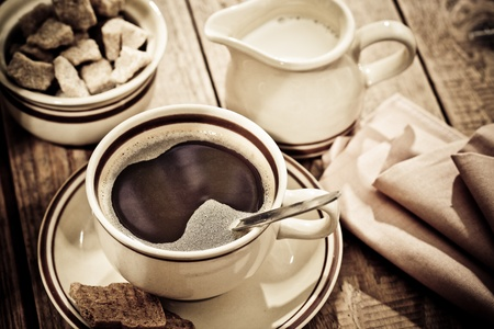 Coffee milk and sugar on wooden table Stock Photo - 10615654