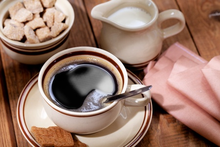 Coffee milk and sugar on wooden table photo