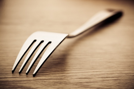 dearth: Silver metall fork and spoon on white background Stock Photo