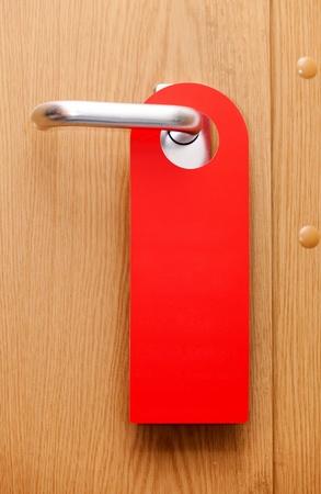 hotel door: blank do not disturb sign on a hotel door.