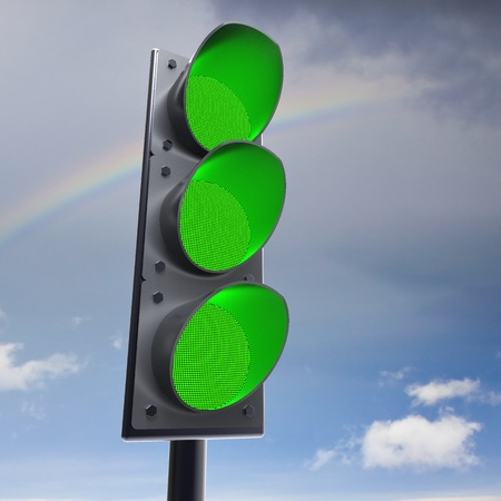 Traffic light on sky background photo
