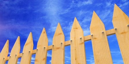 Fence from wooden boards against the dark blue sky photo