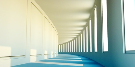 Bend of an empty corridor with windows and a sunlight photo